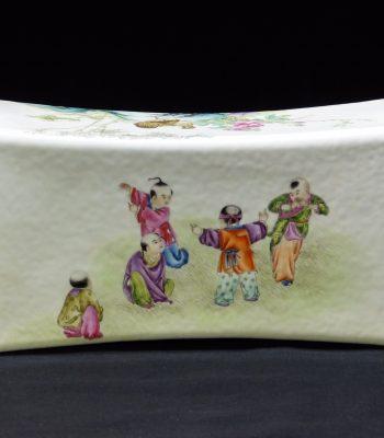清 粉彩人物婴戏花鸟纹瓷枕